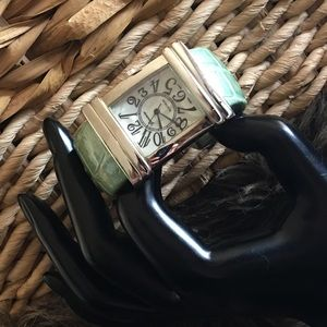 Geneva Platinum green croc embossed cuff watch
